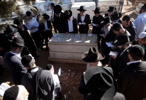 At Rav Ovadia's grave