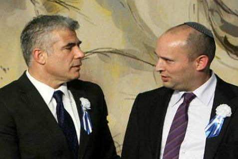 Jewish Home leader Naftali Bennett (right) lost the vote for a bill to stop terrorists from going free. Yesh Atid leader Yair Lapid (left) voted against the bill.