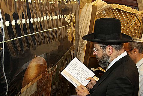 Israel's Chief Ashkenazi Rabbi David Lau prays during his visit to Rachel's Tomb near Bethlehem in August.