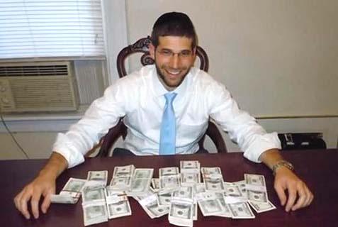 Rabbi Noah Muroff with cash.