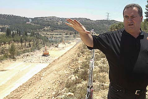 Transpiration Minister Yisrael Katz observing a new highway being constructed between Jerusalem and Tel Aviv.