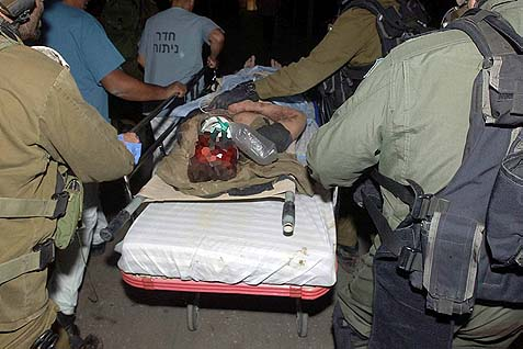 One of the five soldiers injured last Thursday being rushed to the OR in Soroka Medical Center in Beer Sheva.