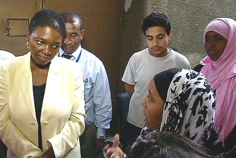 Humanitarian Affairs chief Valerie Amos with refugee children temporarily living in a school in Zahera, Damascus. U.S. and Iranian diplomats responded favorably to her cry for help, and the relationship between the two countries is getting that much warmer.