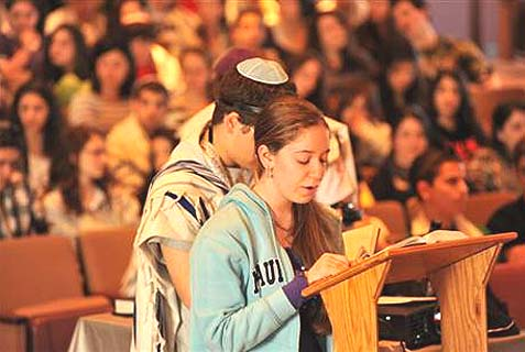 "Teens lead their own religious services at a USY weekend ""Kinnus."""