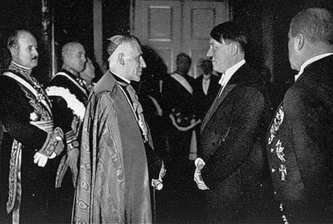 Catholic official greeting a fellow Roman Catholic. A NY based interfaith organization is trying to revise the controversial pontiff's record, so the pesky Jews stop objecting to the Church declaring him a saint.
