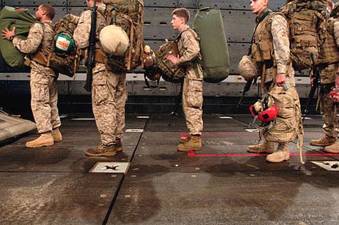 U.S. Marines attached to the 26th Marine Expeditionary Unit boarding a landing craft in the Persian Gulf.