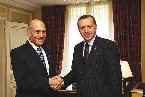 "Former Israeli Prime Minister Ehud Olmert, who was later forced to resign over corruption charges, shaking hands with Turkish Prime Minister Recep Tayyip Erdogan, who just managed to block his own indictment, by replacing the prosecutor investigating his case. Put a picture of Nixon in the background and you got yourself a ""birds of a feather"" tableau."