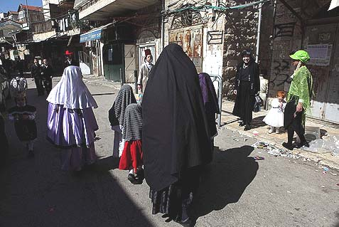 """Jewish Taliban"" women dressed in head to toe robes walking through Meah Shearim, in Jerusalem. Members of the same cult in Ontario, Canada, are in a legal fight with authorities to retain their 130 children."