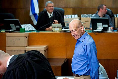 Former Israeli prime minister Ehud Olmert at his corruption trial in a Tel Aviv court. He was convicted on one count of breach of trust, while another trial is still pending. Now he's Obama's water carrier on Iran.