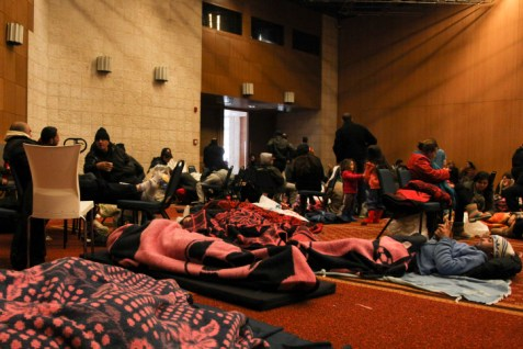 Israelis trapped by snow in Jerusalem rest in a temporary emergency support station.
