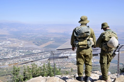 Two IDF soldiers overlooking Kiryat Shmona.
