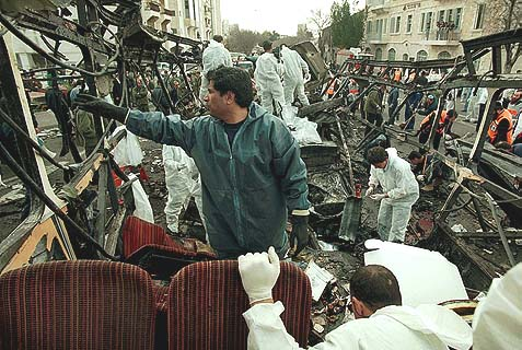 Paramedics and rescue workers at the site of a terror attack in Jerusalem, February 26, 1996. A suicide bomber blew himself up on this bus, killing 26 people and injuring 80 more. This is what peace negotiations look like as they near the crescendo phase.