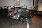 A bullet ridden Jeep Grand Cherokee in a carport (illustration image).