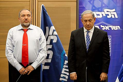 An amicable divorce: Prime Minister Benjamin Netanyahu (R) and Foreign Minister Avigdor Lieberman will be running in two separate party lists next national elections.