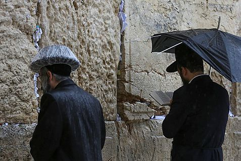 Neither rain, nor sleet, nor gloom of night can keep Jews from praying at the Western Wall.
