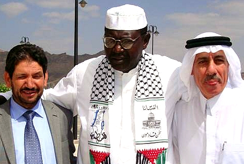 "Malik ""Roy"" Obama (center), brother of President Obama, wearing Hamas keffiya in 2010 photo"