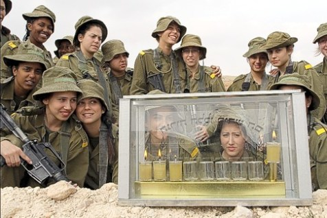 Female IDF soldiers lighting Chanukah candles.