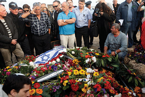 Israelis pay their respects and lay flowers on the grave of Ariel Sharon at his ranch in the southern Negev. The former prime minister died Jan. 11 after being comatose for eight years.