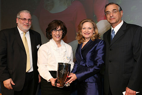 (L-R) Dr. Michael Held, executive director of ETTA; Sharon Levine, co-president of ETTA-OHEL's board of directors; and Liebe and Ivor Geft, recipients of the ETTA Champions Award.