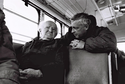Major General Ariel Sharon talks with David Ben Gurion during a bus ride along the Israeli Army positions on the Egyptian border.