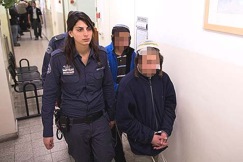 Young Jewish boys from Eish Kodesh accused of initiating a violent incident in Qusra village arrive for a court hearing in Jerusalem.