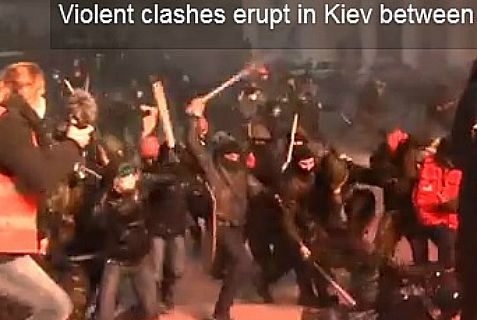 Protesters and police clash in Kiev on Wednesday. The death toll is three, so far.