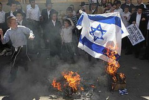 Members of Neturei Karta gathered last year to burn the national flag on Israel's Independence Day.