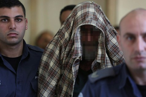 The exterminator who left the poison that led to the deaths of two children in Jerusalem is seen during a court hearing in Jerusalem on January 23, 2014.