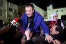 Released Palestinian prisoner speaking to the media at the Muqata presidential ground in Ramallah.