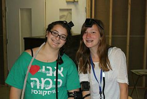 Girls wear tefillin at Camp Ramah in Wisconsin