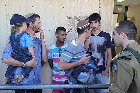 Israelis of all ages waiting to be drafted.