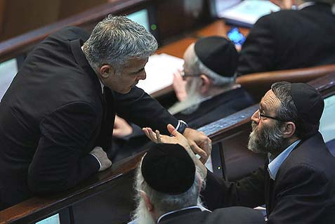 Israeli Finance Minister Yair Lapid (leaning) arguing with Haredi MK Moshe Gafni (UTJ). The new Supreme Court ruling is good for Lapid, who's showing his voters he's tough on Haredim. It's also good for the Haredi leadership, who will be able to galvanize support in their war against the heathen Zionists.