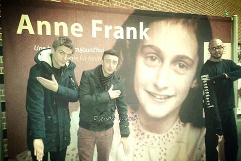 Quenelle in front of an Anne Frank poster.