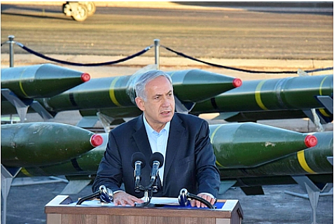 Israeli PM Binyamin Netanyahu standing in front of an intercepted shipment of missiles and weapons, sent by Iran to Hamas in Gaza. March 10, 2014.