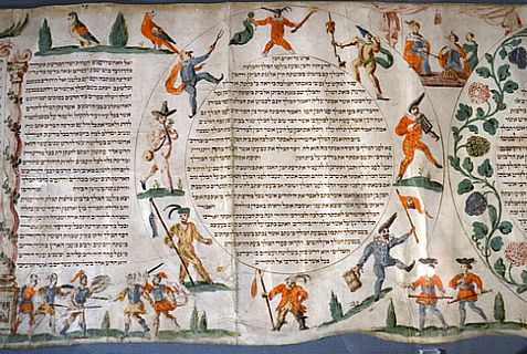 A Hebrew scribe restored a scroll of the Book of Esther (similar to the one pictured here), which tells the story of Purim, for a Catholic nun order.