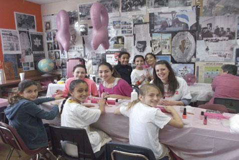 Students raise money for Sharsheret with ManiCure fundraiser.