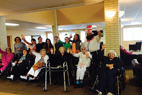 Chaya Aydel Seminary students and Rabbi Yossi Lebovics (back row) bring Purim joy to residents of a retirement home.