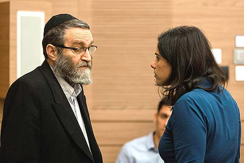 Jewish Home MK Ayelet Shaked (R) speaking with UTJ MK Moshe Gafni, during a Shaked Committee debate of the IDF conscription. In a closed meeting with Tzanz Chassidim, Gafni reportedly said he wanted to drop a desk on this woman.