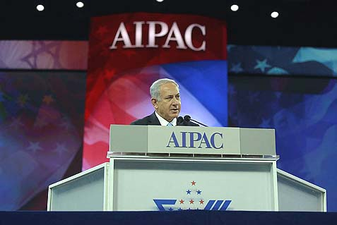 Prime Minister Benjamin Netanyahu speaking at the AIPAC policy conference in Washington DC, USA. Tuesday. He called for enhanced sanctions on Iran, despite Obama's objection.