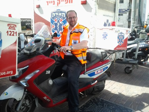 Chazzan Shlomo Glick on his United Hatzalah ambucycle.