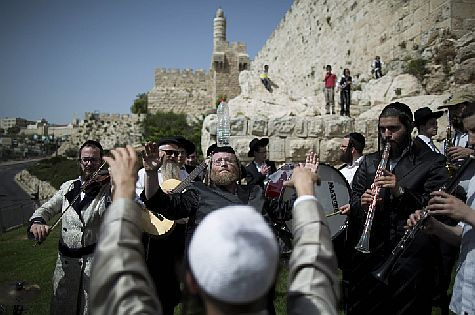 Celebrating around the walls of the Old City of Jerusalem during Passover