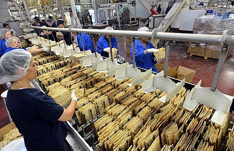 "At the "" Matzot Carmel "" bakery in Petah Tikva, Jewish workers prepare matzas for Passover."
