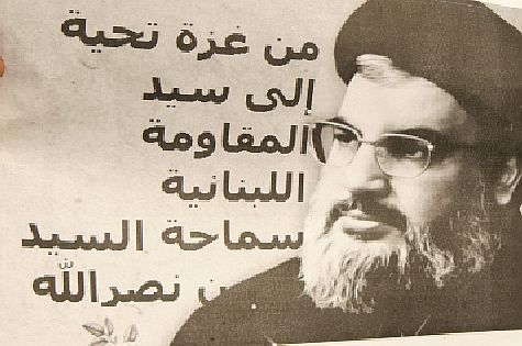 Poster of Hezbollah terror chief Hassan Nasrallah held by Palestinian Authority protester