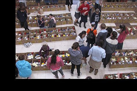 Volunteers preparing food packages.