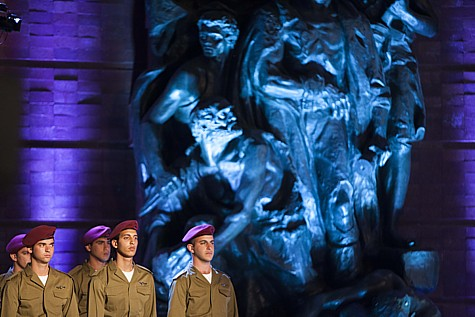 Israeli soldiers stand below a monument as they attend a ceremony at the Yad Vashem Holocaust Memorial Museum in Jerusalem, as Israel marks the annual Holocaust Remembrance Day. April 27, 2014. Photo by Yonatan Sindel/Flash90