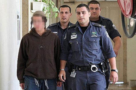 Police escort into court a minor who is suspected of slashing the tires of an IDF Brigade in Yitzhar, in Samaria, April 2014
