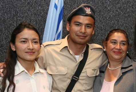 Corporal Diego Tapia with his mother and sister.