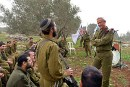 IDF CHief of Staff Benny Gantz speaks with soldiers during a visit at the IDF Netzah Yehuda Battalion  near Jenin on March 2, 2014.