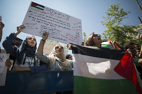 Arab Israeli and left wing student activists hold protest during a rally marking the upcoming Nakba anniversary at the Hebrew University in Jerusalem on May 14, 2014.