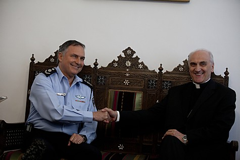 Israeli Police Commissioner Yohanan Danino (L) meets with Papal Nuncio to Israel Archbishop Giuseppe Lazzarotto at his residency in Jerusalem on May 18, 2014 ahead of the upcoming visit of Pope Francis to Israel.